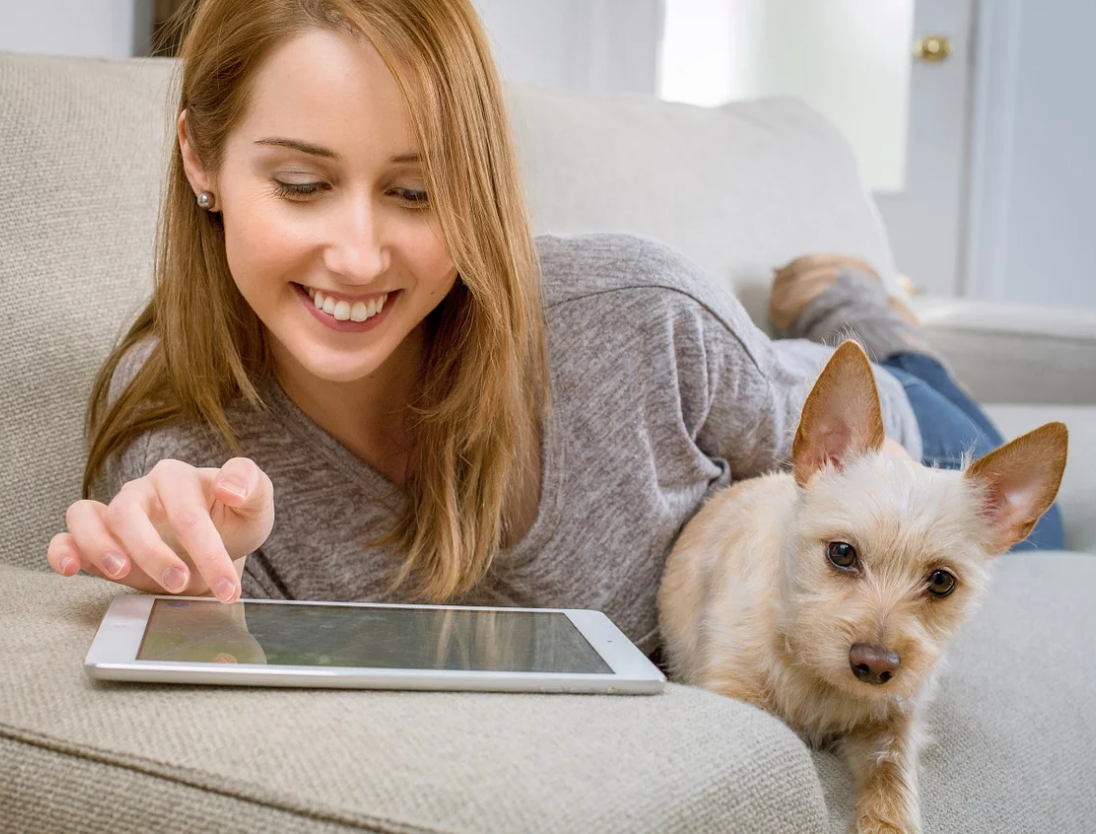 Woman Loving BestValuesSite.com with Dog
